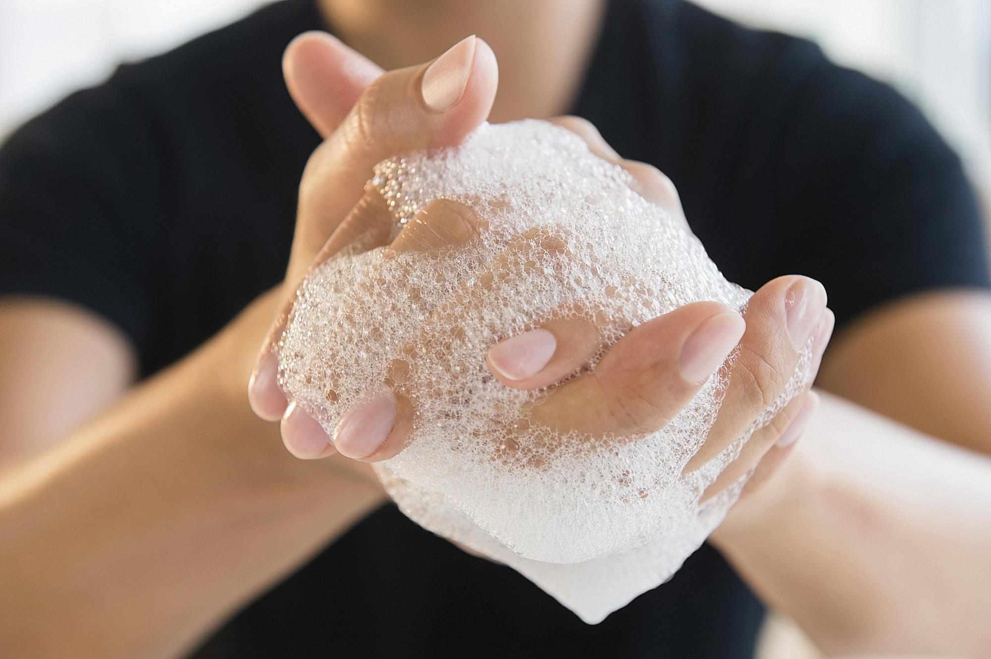 Close up of mixed race man washing his hands