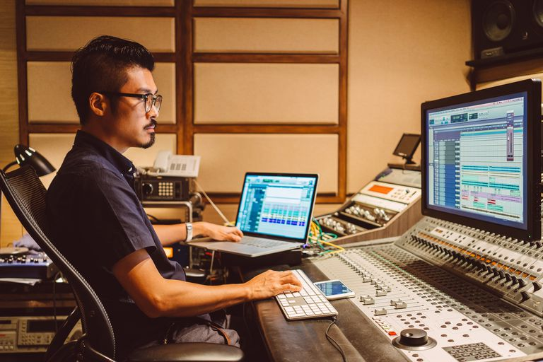 Audio Engineer working in recording studio.