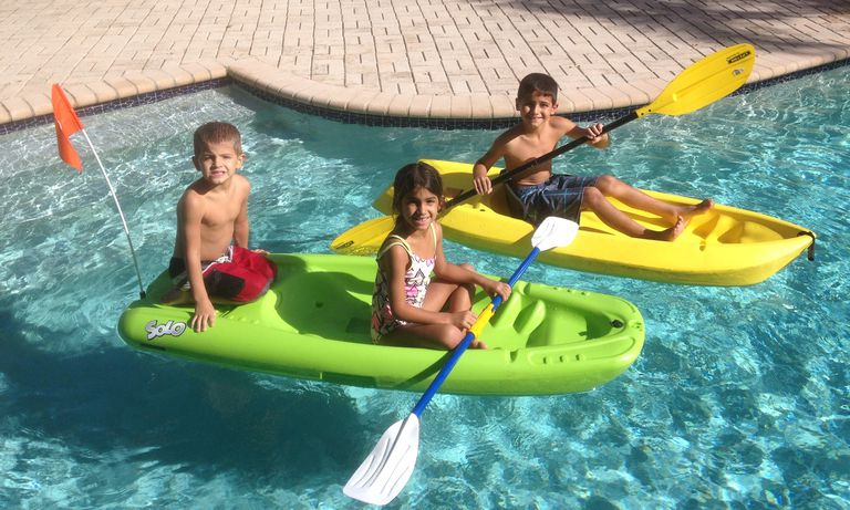 Kids in kayaks in a pool