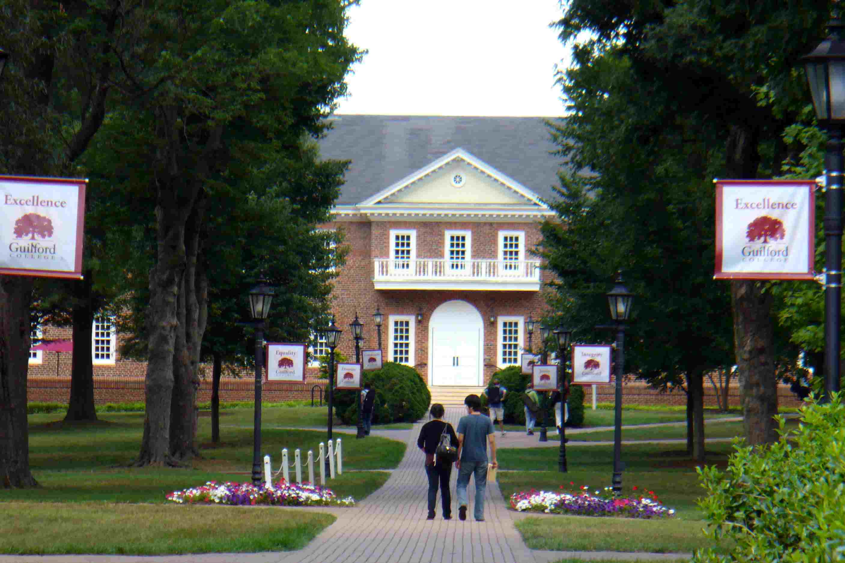 Two students on the brick walkway through Guilford College in the southeastern United States