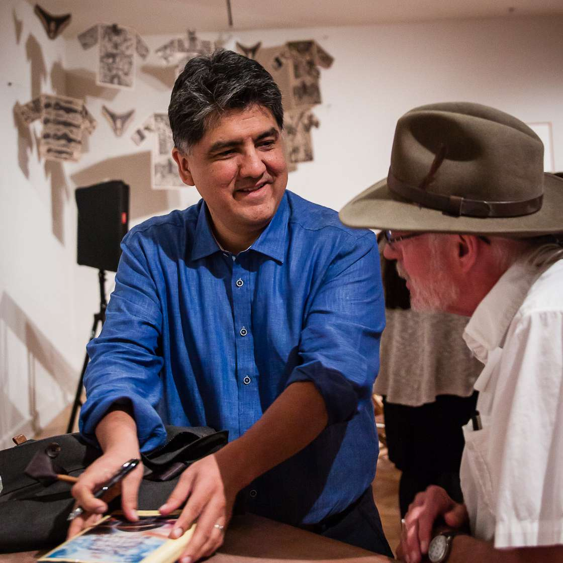 Sherman Alexie chats with a fan at an event at Arizona State University in 2016.
