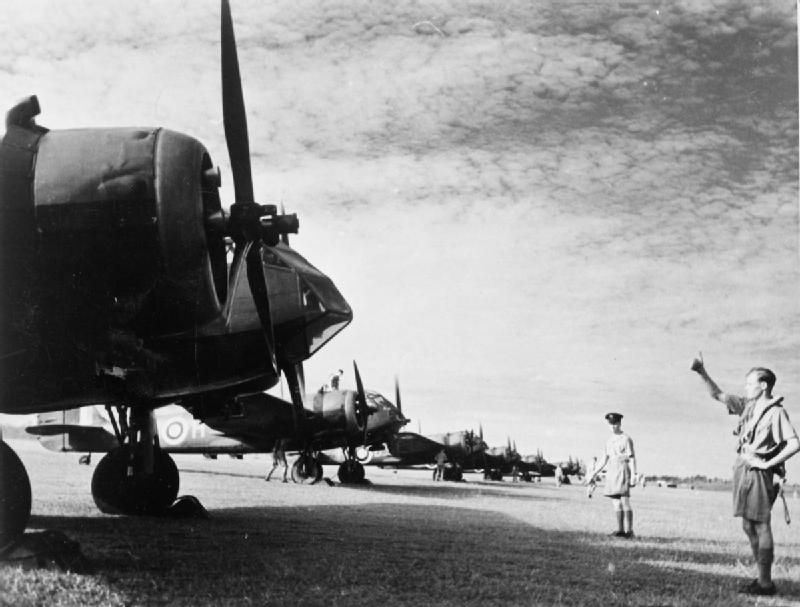 A row of Bristol Blenhiem bombers lines up on a the runway in Singapore.