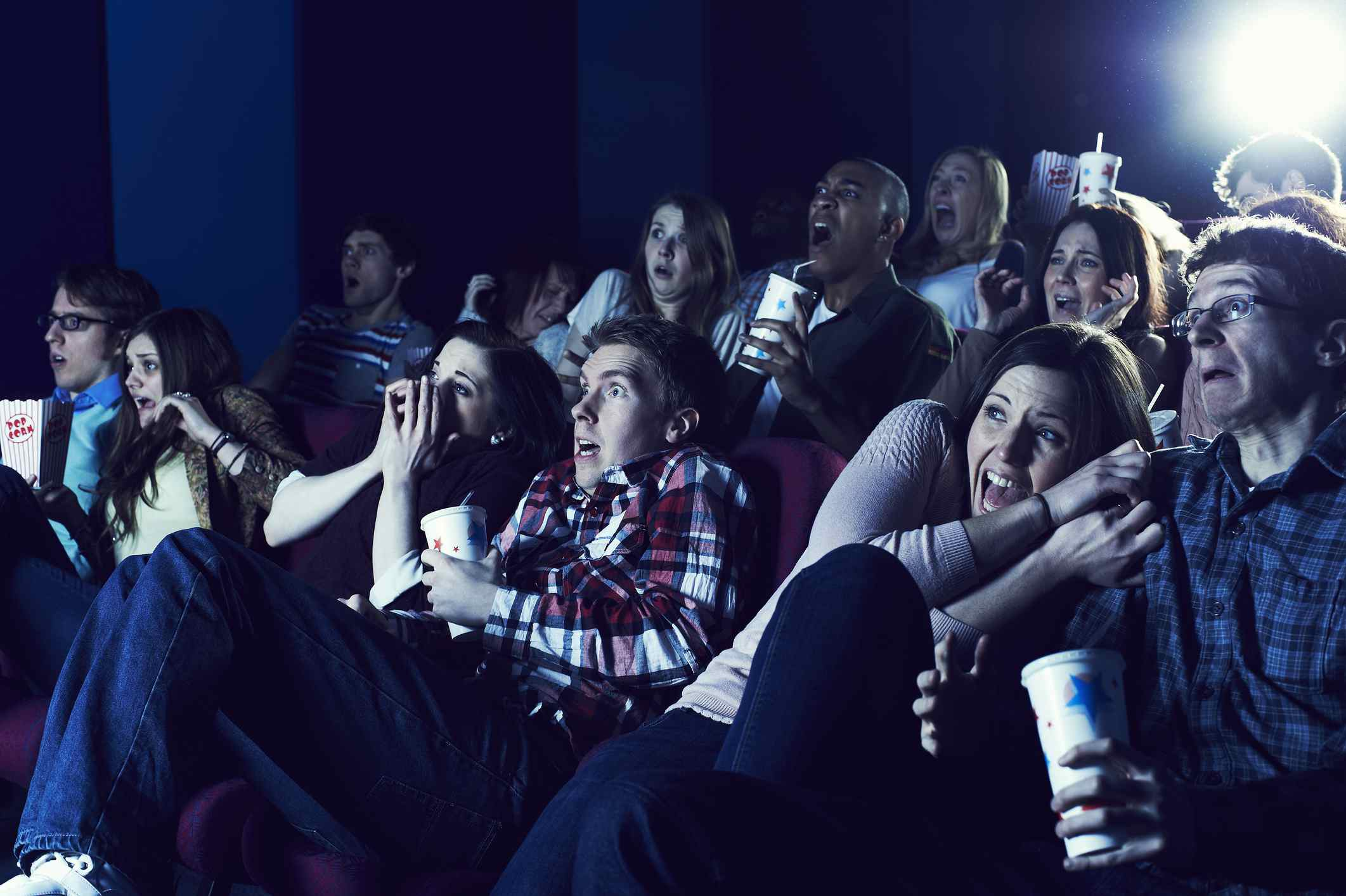 Scared people in a movie theater symbolize Barry Glassner's Culture of Fear.