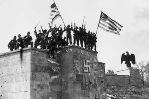 U.S. Soldiers on a Nazi monument on V Day in Germany