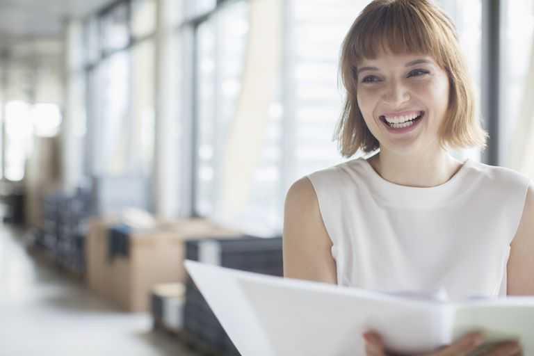woman laughing in business office
