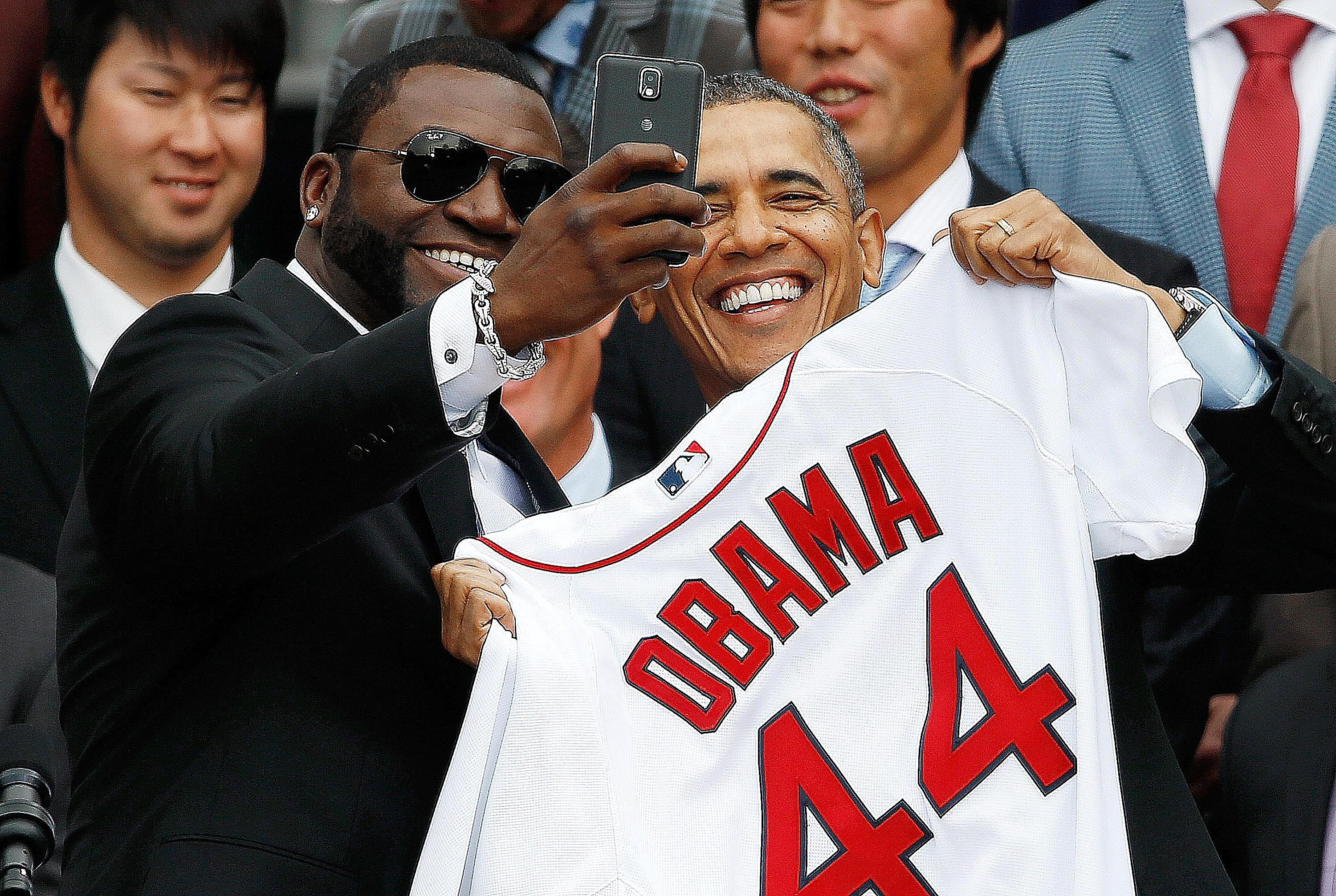 President Obama and David Ortiz of the Boston Red Sox take a selfie together at the White House ceremony honoring the 2013 World Series Champions. Learn how symbolic interaction theory helps explain the popularity of the selfie.