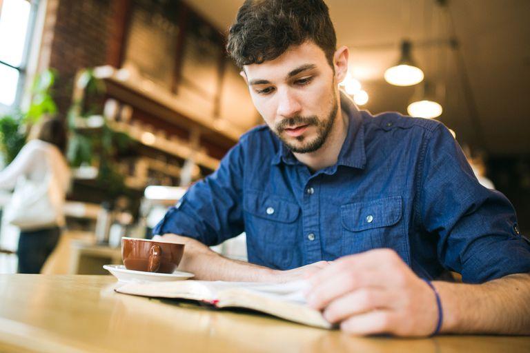Man reading New Year's Bible Verses