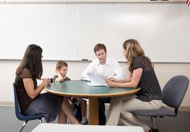 Parents and child meeting with teacher