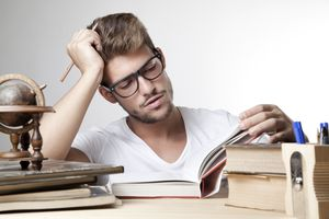College student studying from a book