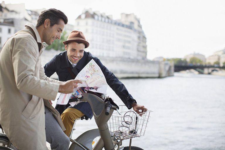 Men looking at map along Seine River, Paris
