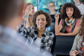 Confident college students answer question in class