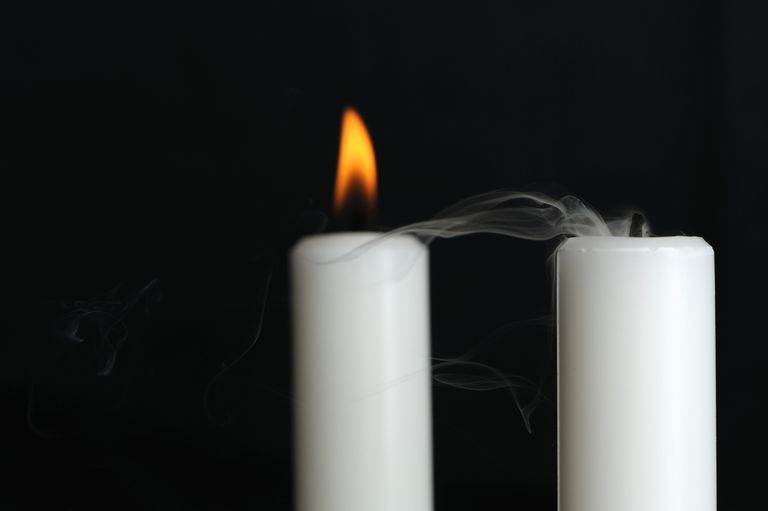 Two candles sit near each other