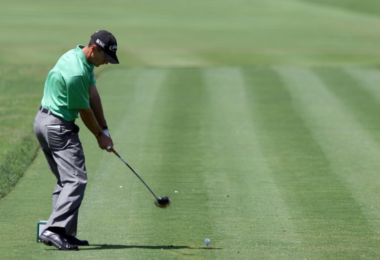 Golfer Charles Howell III plays a stroke