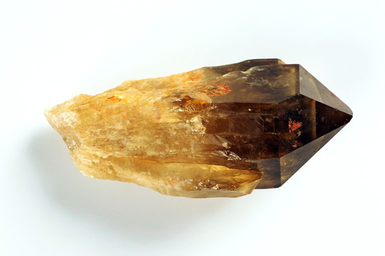 A fiery, smoky, golden quartz crystal
