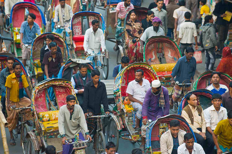 Busy rickshaw traffic on a street crossing in Dhaka, Bangladesh