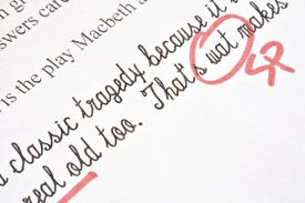 Proofreading marks on typed paper about Macbeth