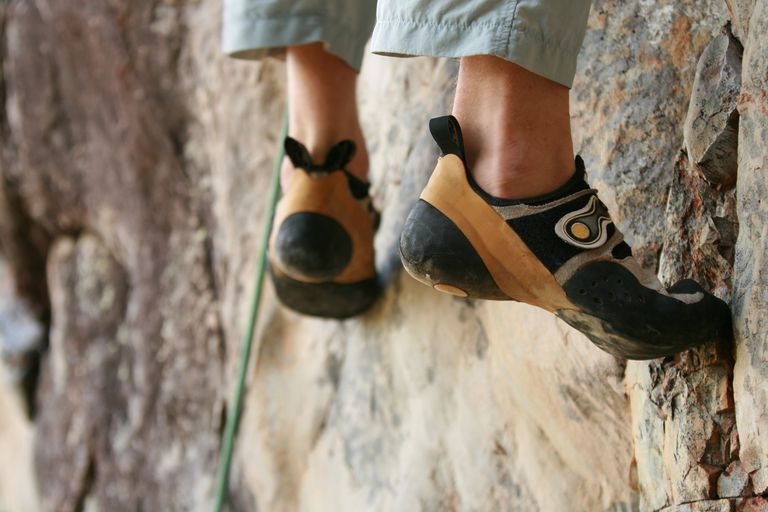 Close up of rock climber's shoes on rocks