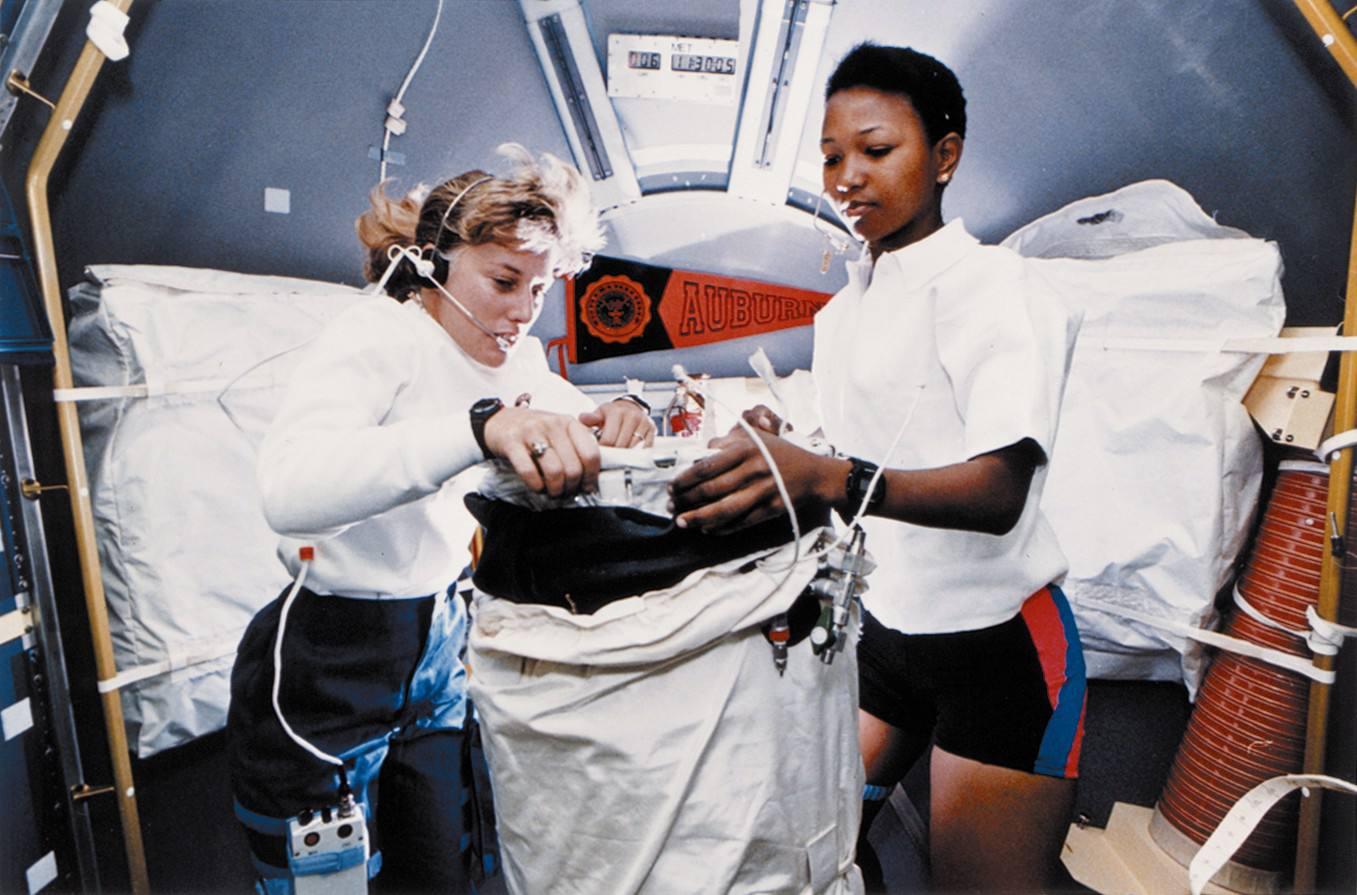 Female astronauts N. Jan Davis and Mae C. Jemison aboard the space shuttle, STS-47, 1992.