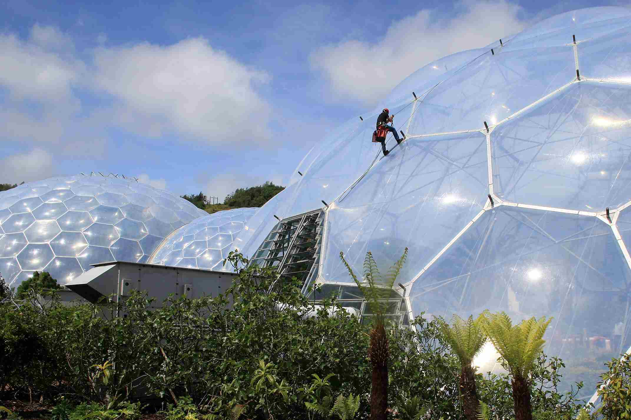 Technician on Rope Descends ETFE Bubbles of the Eden Project in Cornwall, England