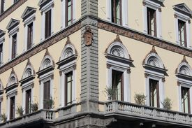 detail of the corner of an ornate stone urban building