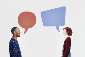Two people with speech bubbles over their heads