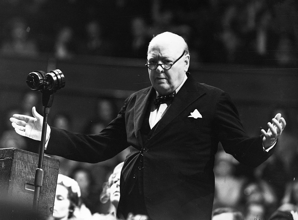 Winston Churchill giving speech and holding his hands out