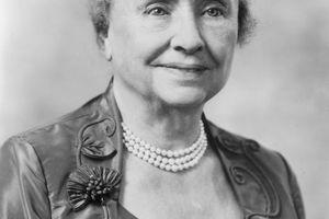 Headshot portrait of American educator and activist for the disabled Helen Keller (1880 - 1968), wearing a pearl necklace and a dress with a semi-square cut neckline.