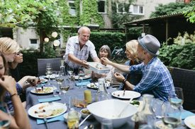 Image of a family having a meal outside