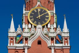 Kremlin Clock on the Spasskaya Tower of Kremlin palace against blue sky in Moscow,Russia
