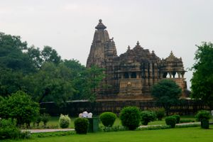 People walking in front of Indian Khajuraho temples.