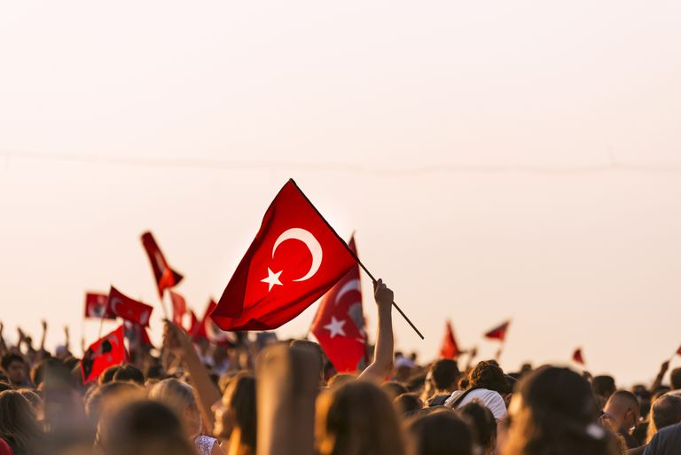 Turkish flag in crowded people