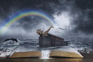 An open Bible with the story of Noah's Ark