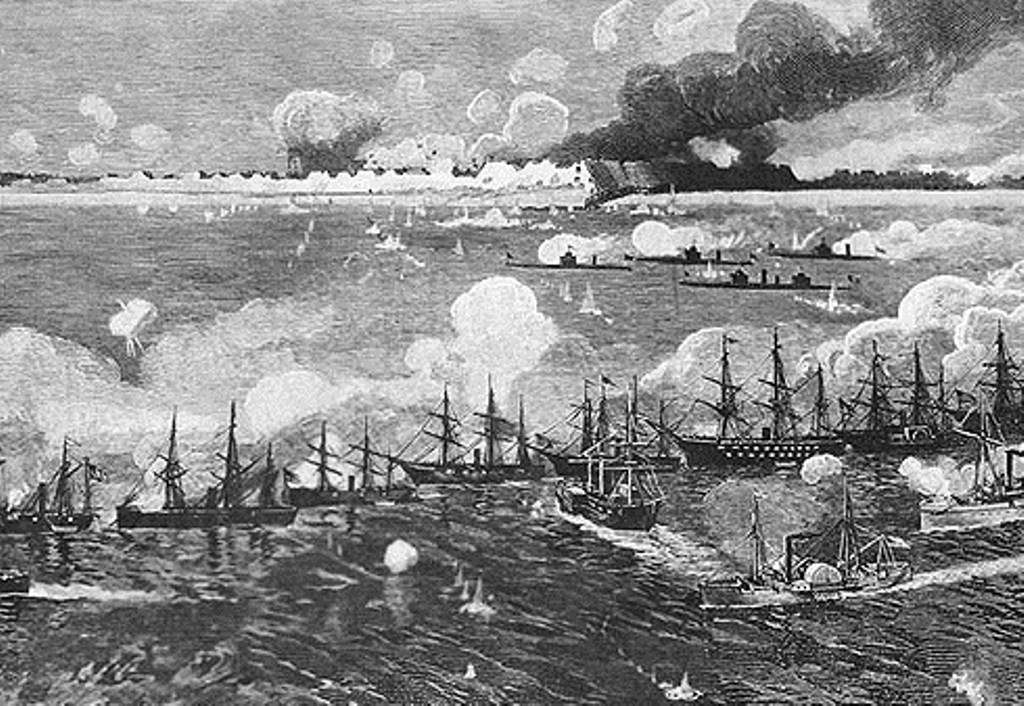 Union warships in a line firing at Fort Fisher.