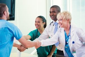 Medical teams greet one another