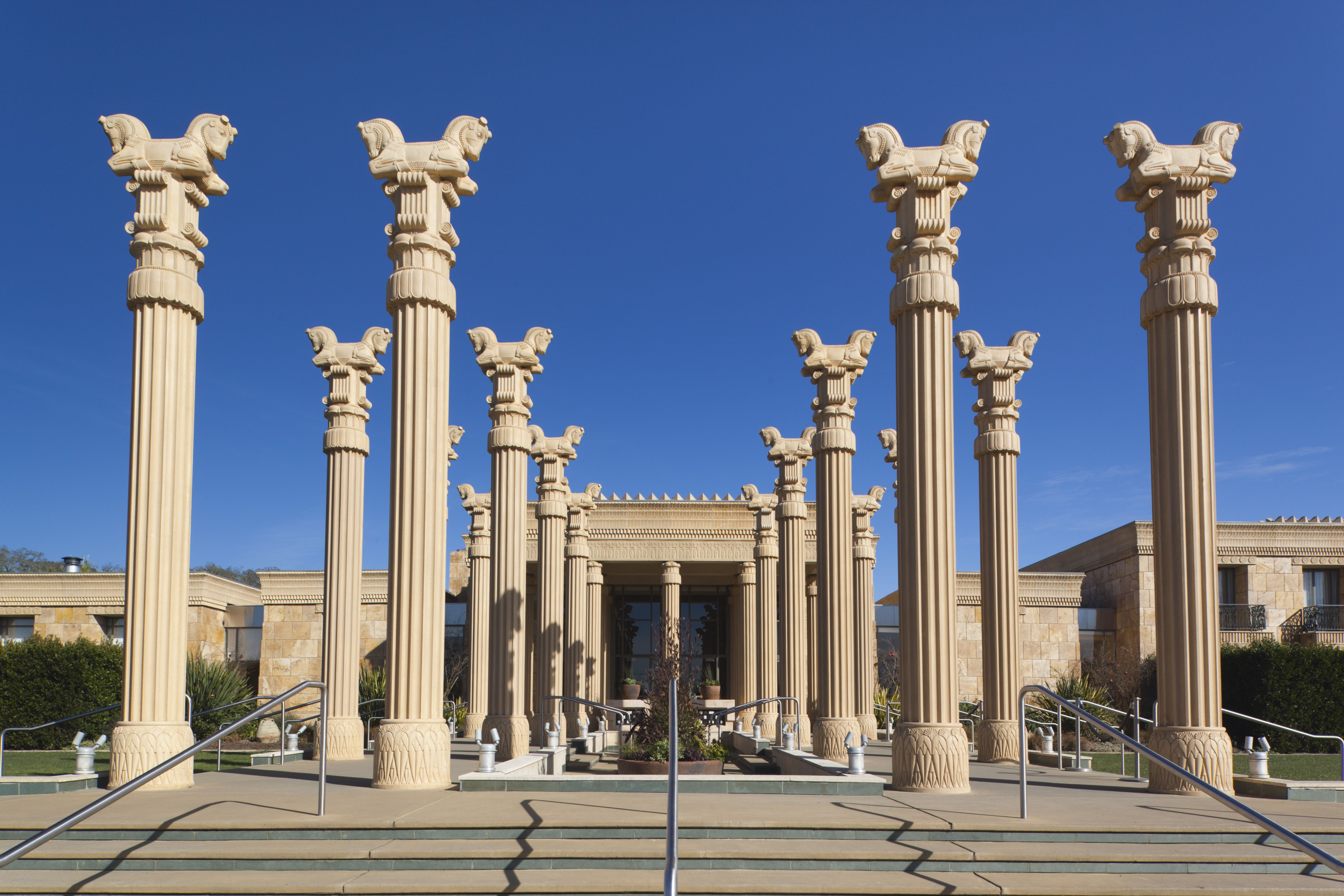 over a dozen Persian columns with fluted shafts and doublt horse head capitals