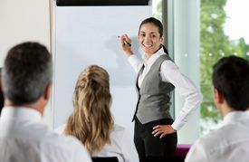 Businesswoman at a whiteboard