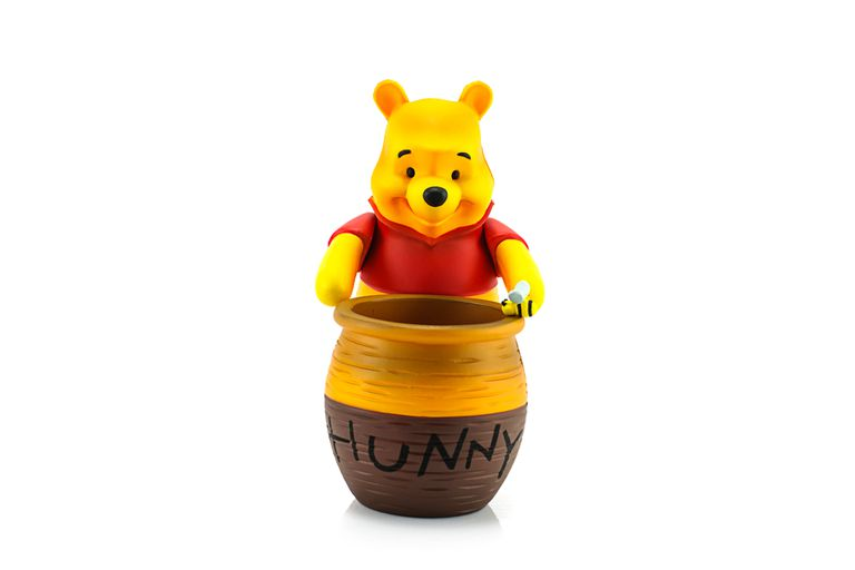 Winnie the Pooh and hunny pot.