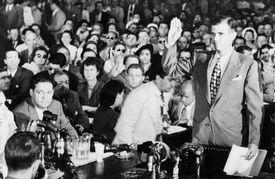 Photograph of Alger Hiss at a Congressional hearing.