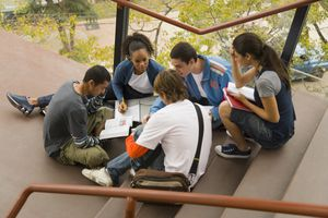 group of college students studying together on an outdoor staiircase