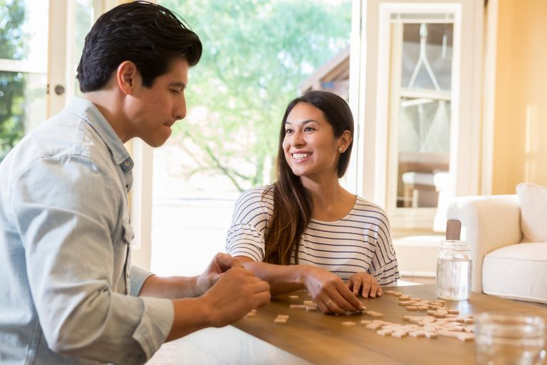 couple playing Scrabble