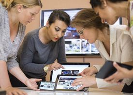 Photo editors discussing over digital tablet in creative office