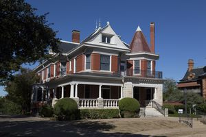 large, multi-gabled Queen Anne style home with turret