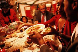 A family shares Christmas dinner together