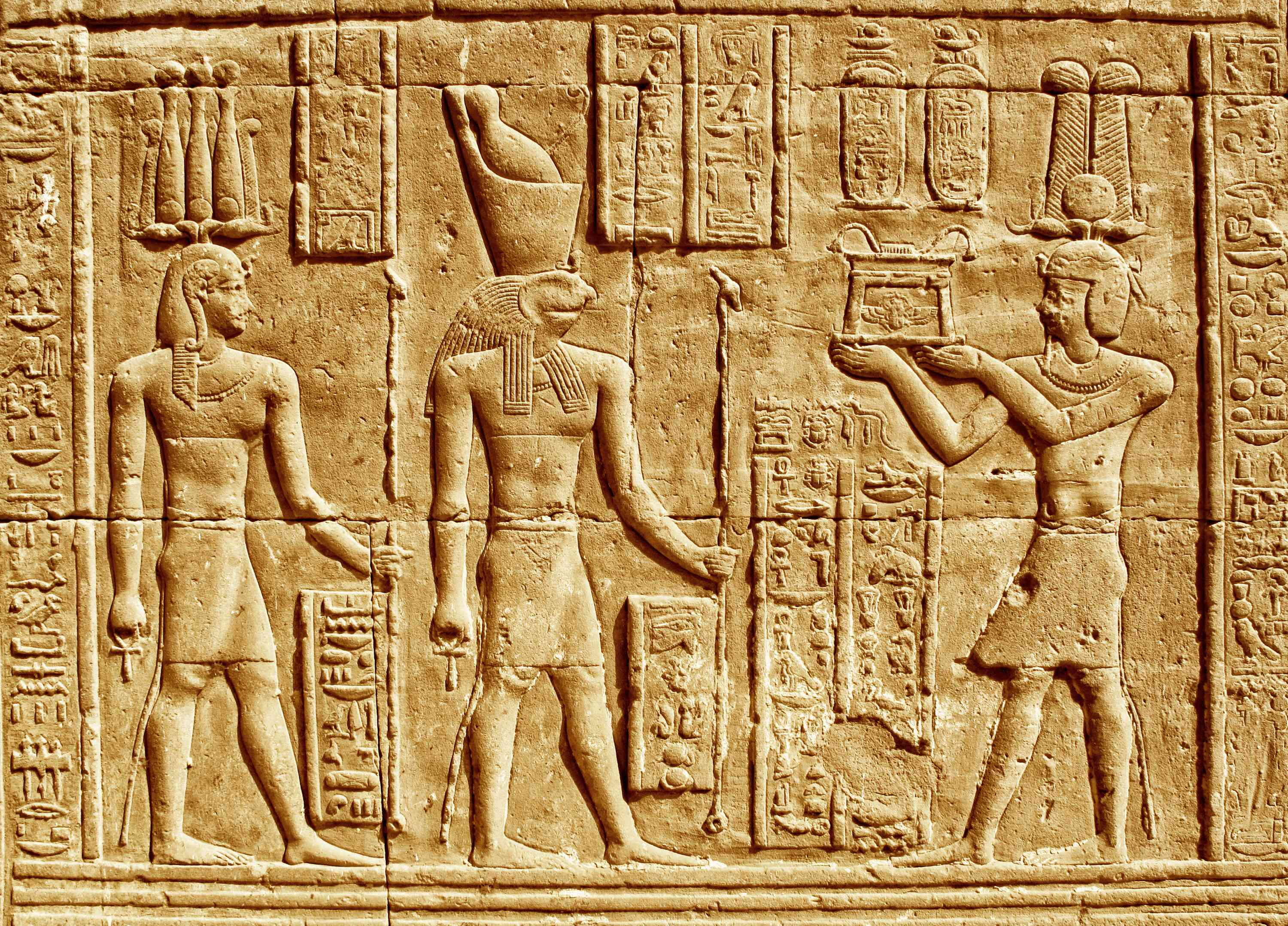 Ancient Hieroglyphics - Egyptian man making an offering to the god Horus.
