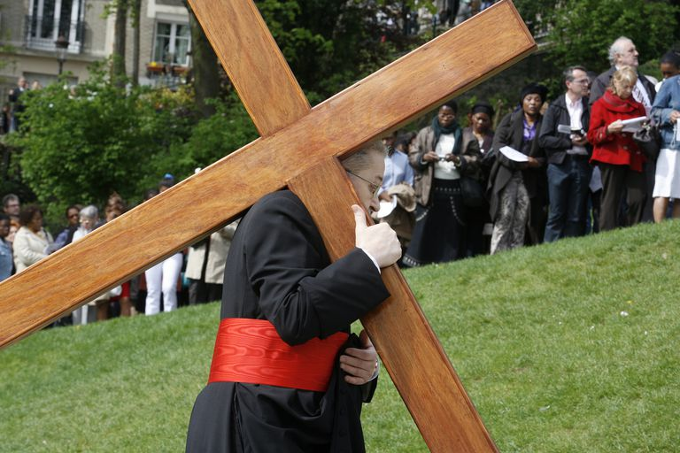 man holding cross
