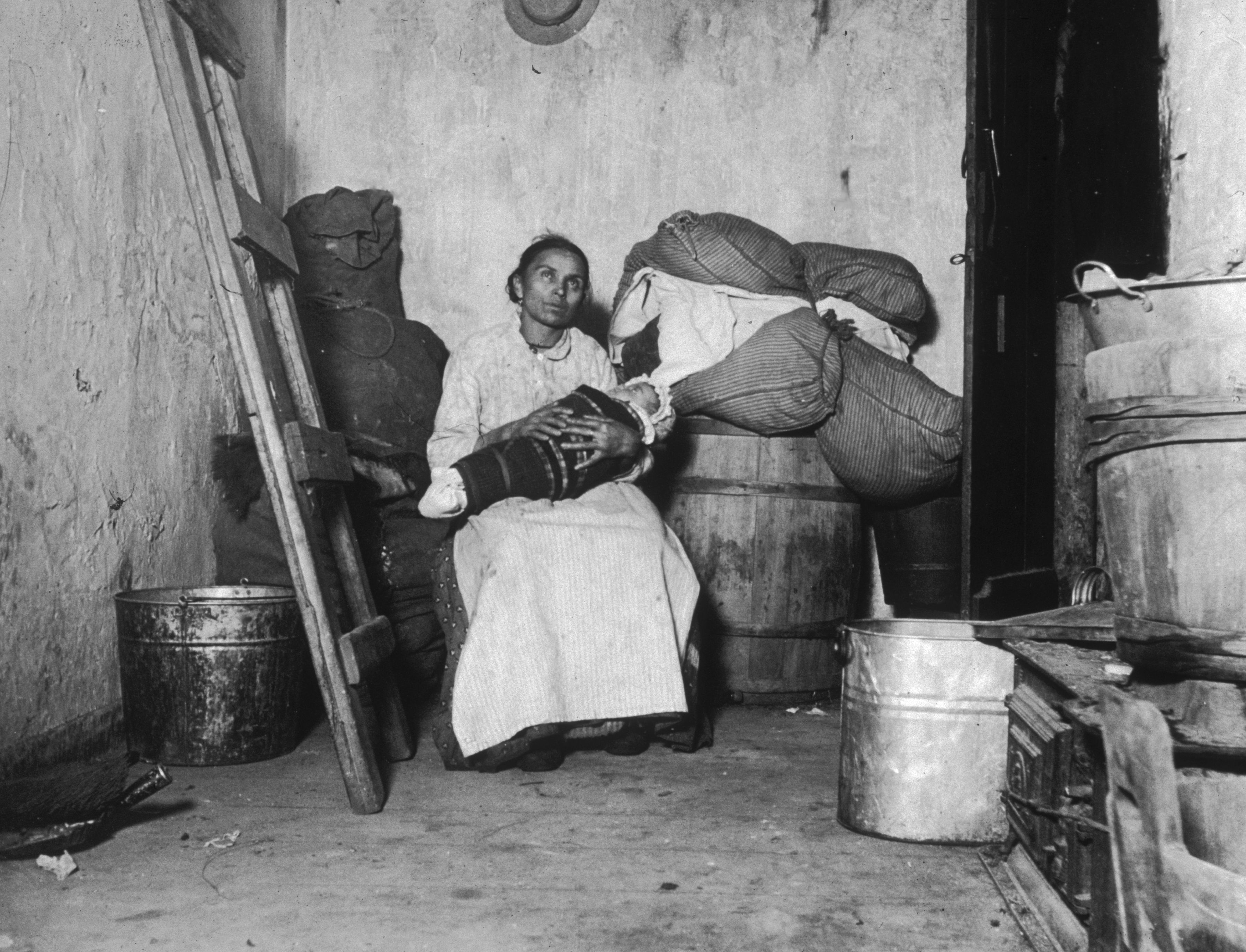 Photo by Jacob Riis of a woman holding a baby