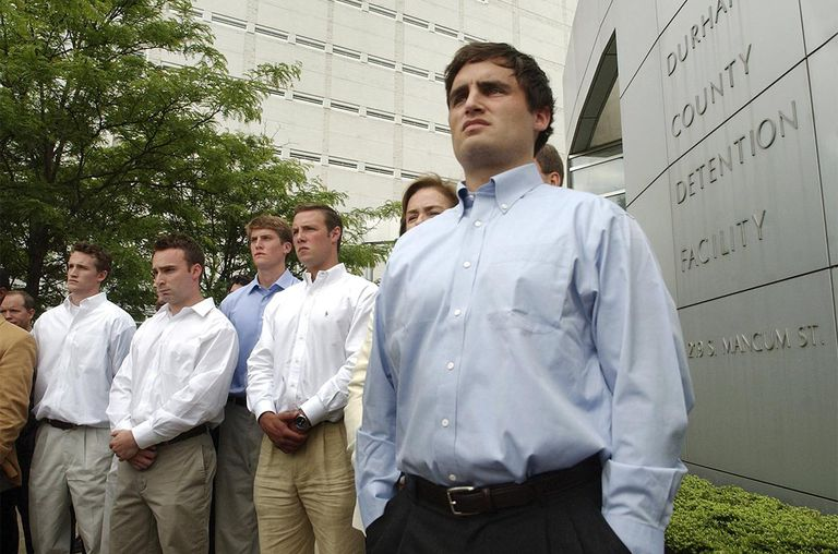 David Evans (R), 23-years-old, stands alongside fellow teammates during a media conference outside the Durham County Detention Center after being indicted on sexual assault charge.