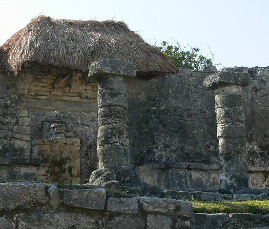 Photo of a thatched roof example on ancient ruins in Tulum.