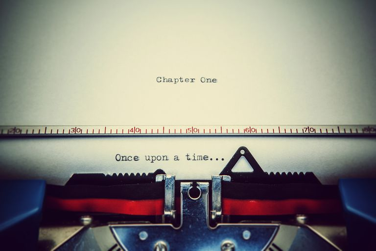 start of a book in a typewriter