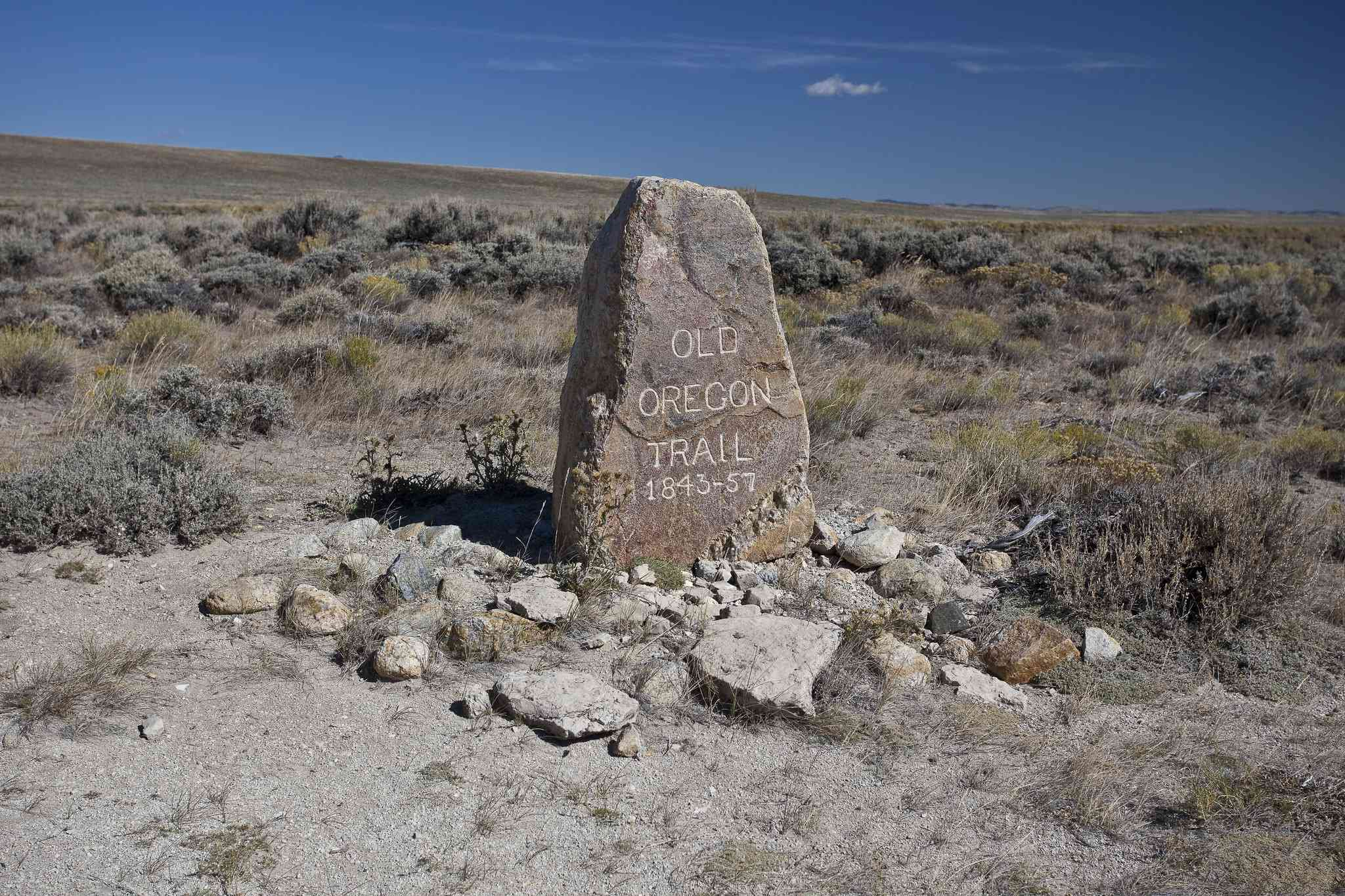 Marker near South Pass on the Oregon Trail under a blue sky.